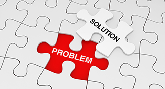 Image of A jigsaw with problem and solution pieces