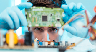 Image of Man looking at computer circuit